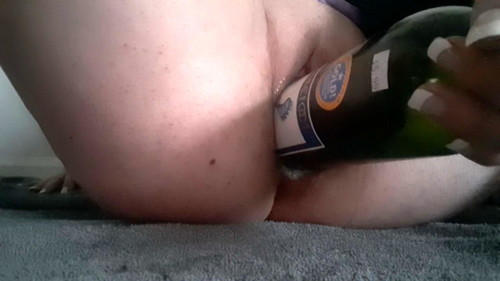 she takes a beer bottle a full jar and a wine bottle cum dri